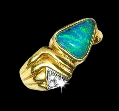 opal ring: triangular shaped black boulder opal with dynamic green blue color in an 18k gold yellow setting, free black velvet gift boxing and shipping