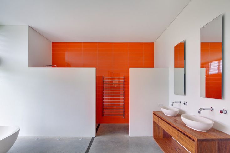 A Mesmerizing Orange Wall Design For Modern Bathroom With Classic Wooden Cabinet With White Washbowls And Frameless Mirror A Modern Addition to the Classic Australian Home Home design