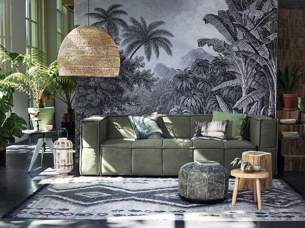 Bringing Conservatory Chic into the home with rattan hanging pendant, botanical wall mural and plants