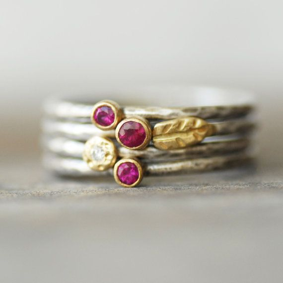 This listing is for a set of Four Ruby and diamond, 18k gold and sterling silver leaf stacking rings.  Red rubies set into rich 18k yellow gold settings. A sparkly white diamond is set into a little gold flower, and a handmade gold leaf completes the set.  Details: Diamond- 1.7mm Conflict free Ruby - 2mm, 2.5mm Silver and gold - Eco-friendly, recycled Bands - 1.6mm sterling silver Texture- hammered Finish - Choose your desired finish when you check out...pictured with the lightly oxidized…