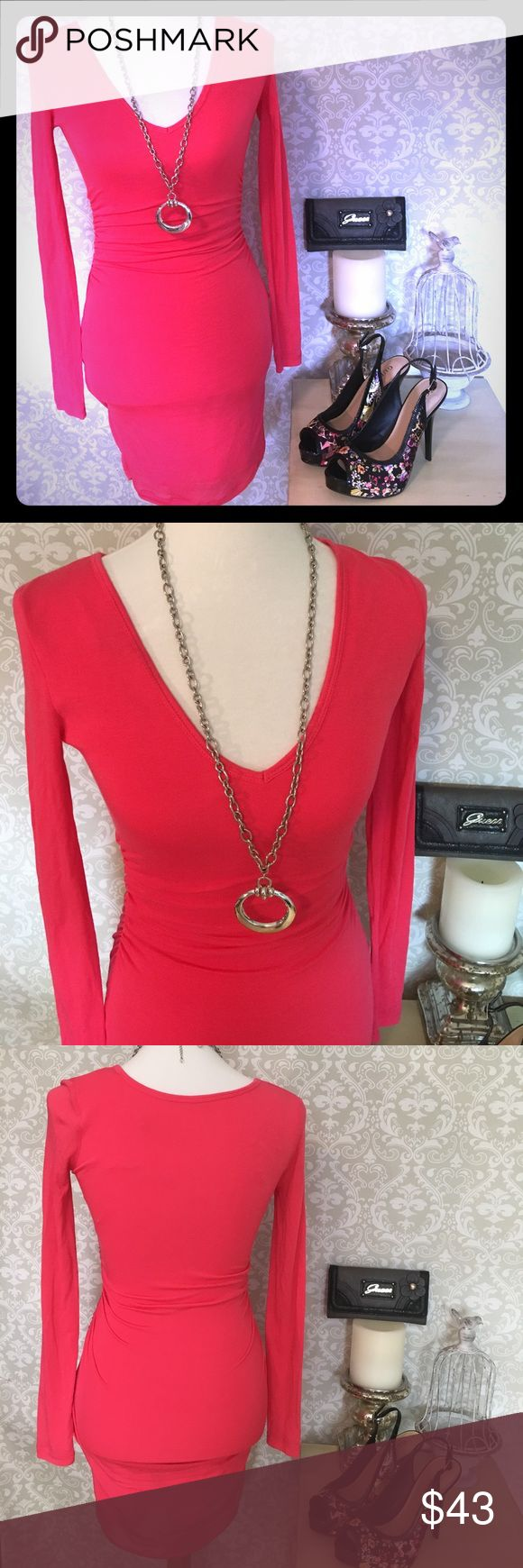 Guess Dress Dress is beautiful red. It's has gathering on the sides as shown. Has a liner. Fabric is soft and just the right amount of cling. 95% Modal 5% spandex. Size Small. Excellent condition. Guess Dresses Mini
