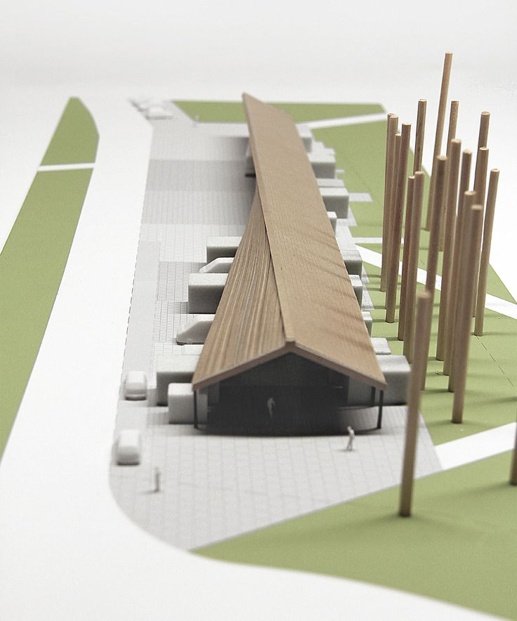 the changing pitch of the shingle roof proposed for the new carnikava market reflects the different functions accommodated by the same volume.