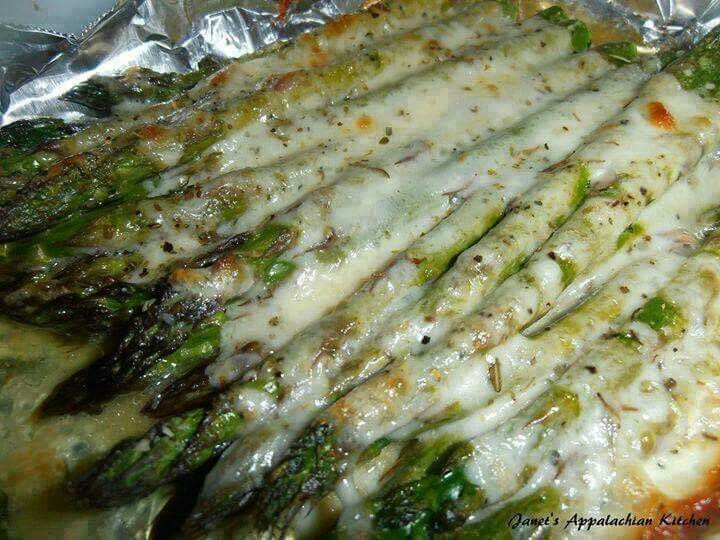 Budget101 Fan Share: Cheesy Baked Asparagus 1 bunch of asparagus, woody ends trimmed 3 T. butter, melted 1/2 tsp. my house seasoning (equal parts garlic powder, onion powder and pepper...combine and store in an airtight container) 1 T. grated parmesan cheese 3/4 C. shredded mozzarella cheese italian seasoning Line a baking sheet with some tinfoil. Place the asparagus on the baking sheet and drizzle with the melted butter. Sprinkle the house seasoning and parmesan cheese over the top...