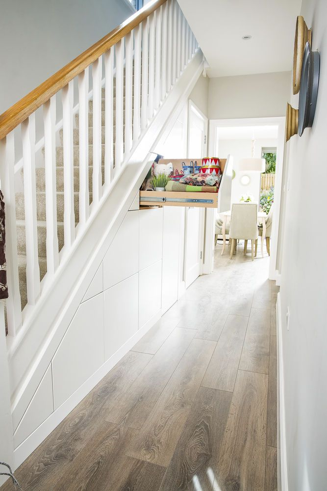 Make the most of your under-stairs area with this stylish and practical idea. Create a secret hideaway with a pull out drawer, like this one from Smart Storage, perfect for a family home. Find more ideas at housebeautiful.co.uk