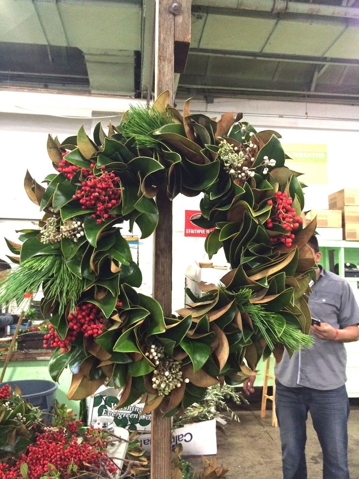 I adore this Magnolia leaf wreath....welcome to a Southern Christmas... Want to Make Your Own Fresh Wreath?: