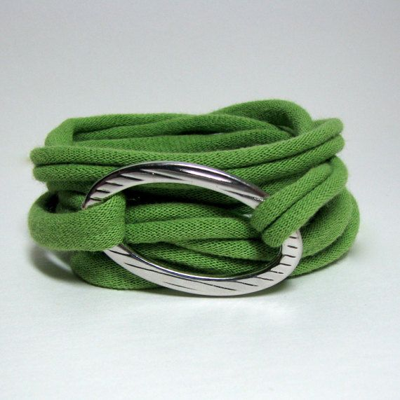 This is an incredibly confortable Wrap Bracelet that is 100% Ecofriendly. It is made from upcycling old T-shirts and repurposing discarded Jewelry. The wrap bracelet will fit many different wrist sizes as it is made from a stretchy material and can be wrapped as many times as needed.  This Bracelet is made from a grey t-shirt and a repurposed metal oval (silver in color). Wash Instructions: Hand wash, air dry