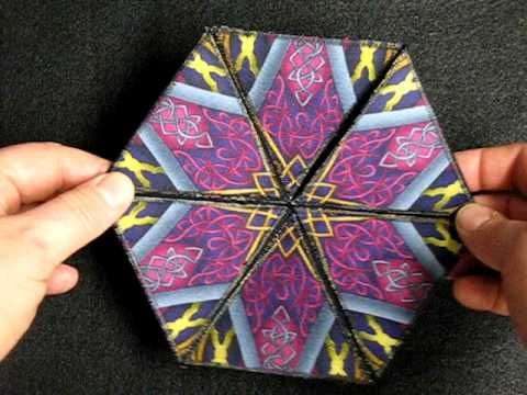 This hexaflexagon is constructed from fabric. By folding and flipping six different hexagons can be created with this hexagon.