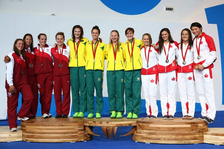 (L-R) Silver medallists Becki Turner, Amy Smith, Francesca Halsall and Siobhan O'Connor of England pose with gold medallists Cate Campbell, Emma McKeon, Melanie Schlanger and Bronte Campbell of Australia and bronze medallists Alyson Ackman, Michelle Williams, Sandrine Mainville and Victoria Poon of Canada