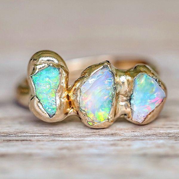 Opal Ring With Diamonds Around It