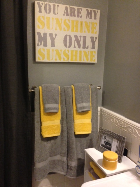 Grey and Yellow Bathroom   Photo from Kohls Towels, Frame and Jar from Target