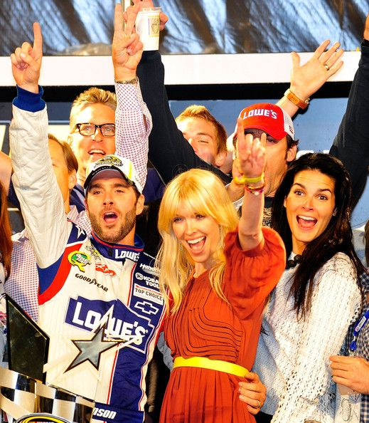 Angie Harmon Jason Sehorn Photos - Jimmie Johnson (L), driver of the #48 Lowe's Patriotic Chevrolet, poses in victory lane with wife Chandra (C), actress Angie Harmon (R), and her husband/former football player Jason Sehorn (Top) after winning the NASCAR  https://www.fanprint.com/stores/nascar-?ref=5750