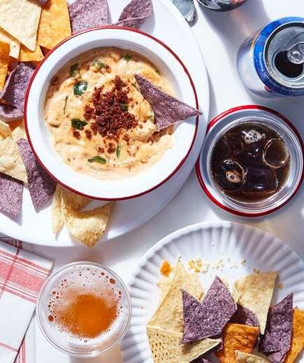 Chorizo and Poblano Queso   Skip the sports bar, invite some friends over, and make your own queso. Cheesy with a kick thanks to the chorizo, this queso is rich and a real rib-sticker. If you can't find poblano peppers, don't fret; grab some green bell peppers instead. The blend of spices such as coriander and cumin really makes this queso extra flavorful and fragrant.