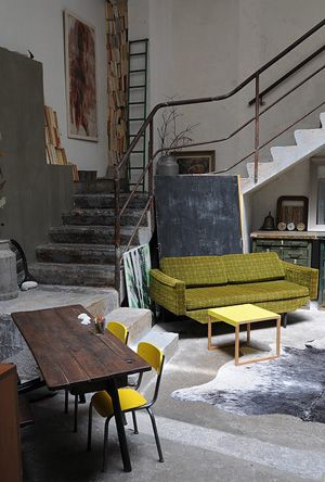 This loft is a great mix of old and modern. It does need some flowers.