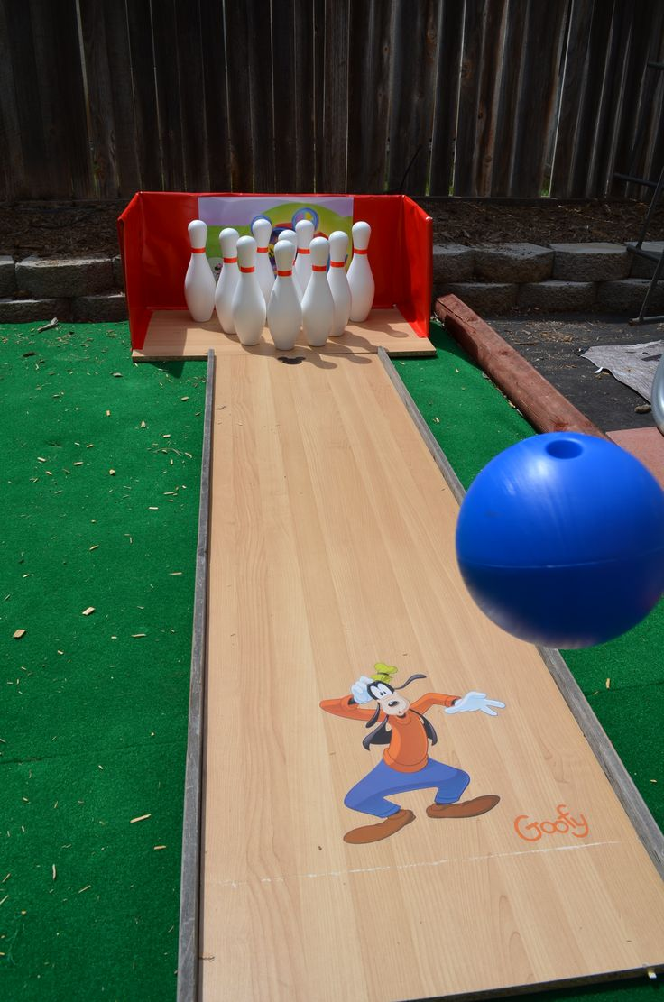 Mickey Mouse 3rd Birthday party, made games and placed them all over the yard, My hubby made a bowling alley, with mickey decals, we added sand to the pins to help them stay better, this was a HIT!