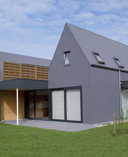 marley eternit thrutone fibre cement slates created an unusual and stunning effect on a house in belgium