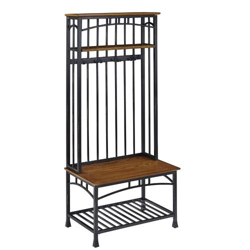 Features:  -Modern Craftsman collection.  -Deep brown powder-coated metal.  -2 Fixed shelves.  -4 Double hooked coat rings.  -Solid wood.  -Not weight tested.  Finish: -Oak.  Material: -Metal/Wood. Di