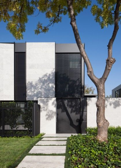 —The challenge of this new home was to fit a generous design onto a compact site. Outside, this meant using every inch of space, yet still retaining a sense of grandeur and openness, such as in the daybed which overhangs the pool. Tundra limestone served as a strong, neutral base used on the front façade of the home, extending through the interior spaces to the rear garden and posts, while white render, black metal work and timber battens added fine detailing and warmth.