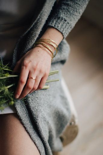 A set of 3 gold bangles with a hammered finish. A classic staple for any occasion! $28 Each item in Paisley + Sparrow's shop has a PURPOSE. This item is handcrafted by a survivor of modern day slavery.  $28 www.paisleyandsparrow.com