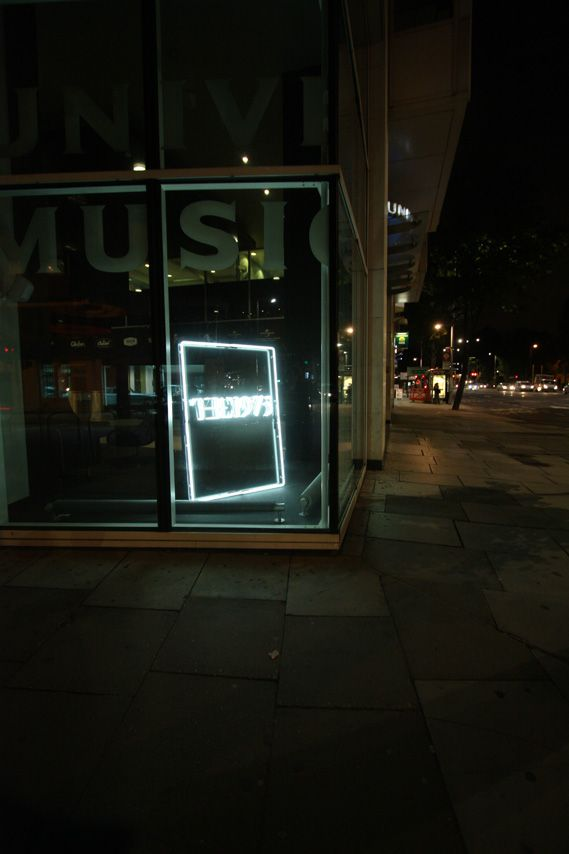 Manchester band The 1975's debut album features a lovely shot of their logo in neon lights against a black background. The cover image was conceived by The 1975 and Universal's Jamie Oborne and Lisa Ward. The neon graphics were designed by Samüel Johnson, built by A1 and photographed by David Drake.  The lighting featured in the shot was on display at Universal's London HQ
