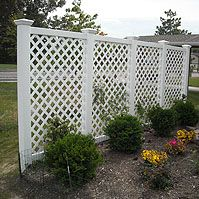 Vinyl Diagonal Lattice Fences by Elyria Fence. open fence for breeze. supplement privacy with climbing plants.