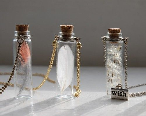 Glass potion bottle, wire wrapping, and a little beading.  Filling these with items found on nature walks would be a great activity for your witchy teen.