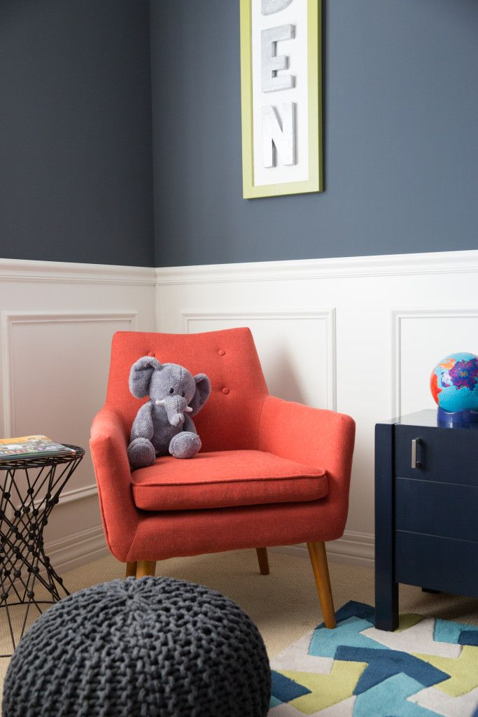 Space-Inspired Big Boy Room Decor, dark navy walls, white wainscoting, red chair