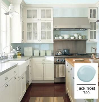 Among the blues, consider a robin's egg, such as Benjamin Moore Jack Frost 729. Greens and blues are generally restful colors that flatter food. http://www.benjaminmoore.com/en-us/paint-color/jackfrost?OVMTC=Broad&site=&creative=12342560153&OVKEY=jack%20frost%20paint%20color&url_id=133054137&adpos=1t1&device=c&devicemodel=&gclid=COuLzLqTxr8CFc1_MgodvzoAwA