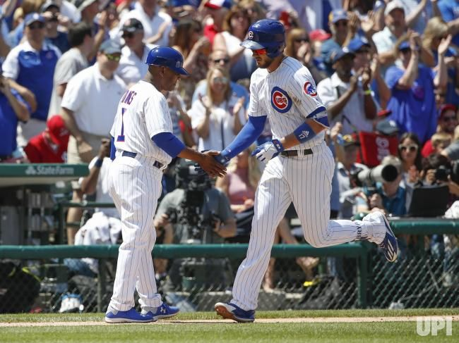 Chicago Cubs Kris Bryant (R) celebrates with third base coach Gary Jones (L) after hitting a solo home run against the St. Louis Cardinals…