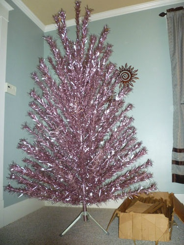 Holy shit! Right now on eBay. 8' pink aluminum Christmas tree!!!! WANT!!!! (Update: this tree sold for over 2K!!!!!)