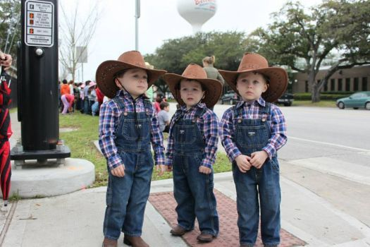 This is one of 20 finalists in the Houston Chronicle's 2014 rodeo photo contest. You can see the rest of the entries and vote for your favorite here: http://www.chron.com/life/article/Houston-Rodeo-Photo-Contest-5270431.php.  The triplets are waiting to greet the Los Vaqueros Trail Ride! 15 - Johnny Mandola