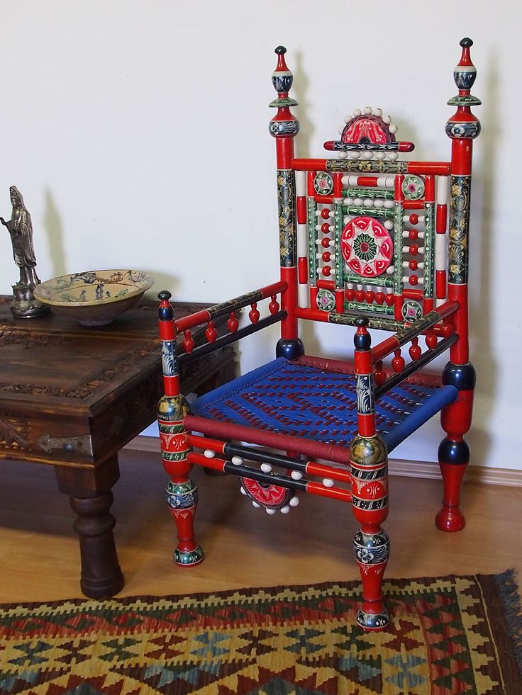 A pair of traditional Punjabi tribal chairs from Pakistan