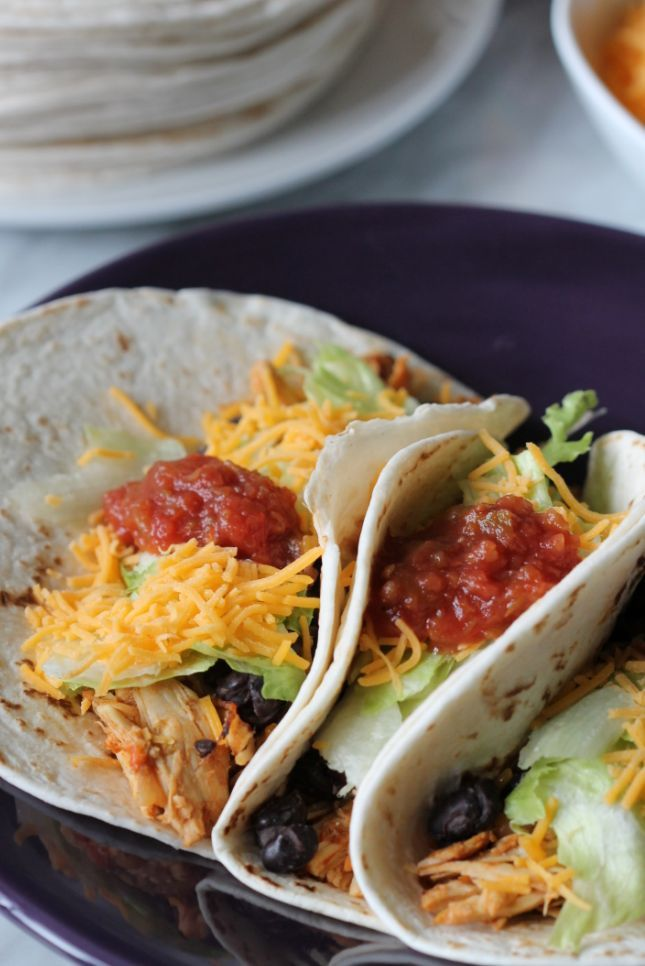 Crock Pot Chicken Tacos! Such an easy recipe (Only 3 Ingredients!) Throw this in the crock pot before you leave in the afternoon and Dinner is ready when you get home!