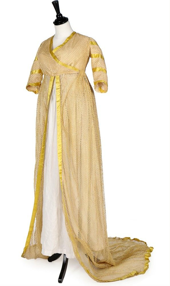 An unusual cotton filet mesh open robe, 1790-1800.    An unusual cotton filet mesh open robe, 1790-1800. possibly for fancy-dress, with empire-line inner bodice panels, cross-over bodice, sleeves and trained skirt edged in yellow ribbon.