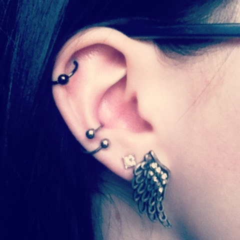 My conch piercing finally healed. This is with my new ear spiral in it. I love it so much!