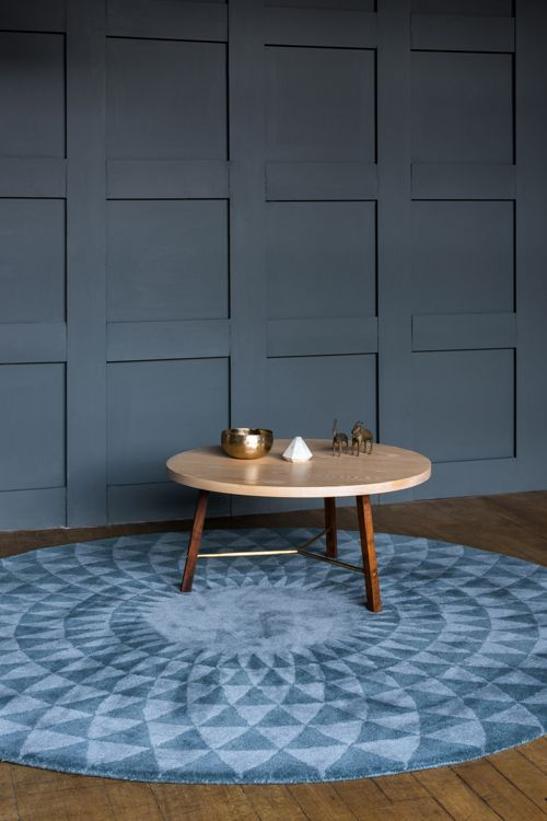 Round rugs in the living room | Niki Jones Concentric rug in stone blue and pewter | Farrow & Ball 'Downpipe' walls | Another Country round table. niki-jones.co.uk