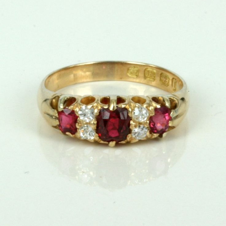 Antique ruby and diamond rings such as this one, are perfect for any occasion, including as a wonderful and vibrant engagement ring.     This ruby and diamondd ring was hand made in 18ct yellow gold in Birmingham 1891, and is still in fantastic condition.     Set with 3 wonderful red natural rubies that total 0.76 carats in weight, instead of being set with one diamond on each side ofthe centre ruby, there are two diamonds each side. The diamond weight is 0.16 carats, giving it that extra…