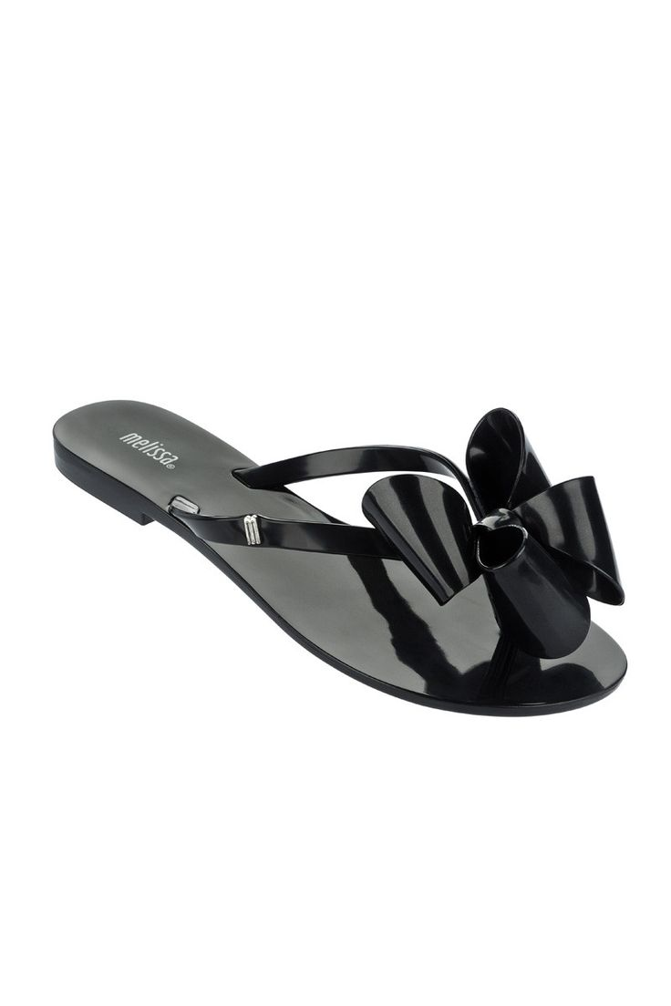 An oversized black bow tops the thong strap of a flexible, flat that's made from fruit-scented PVC. - PVC upper, lining and sole. - By Melissa; made in Brazil. Whole sizes only; for N width 1/2 sizes,