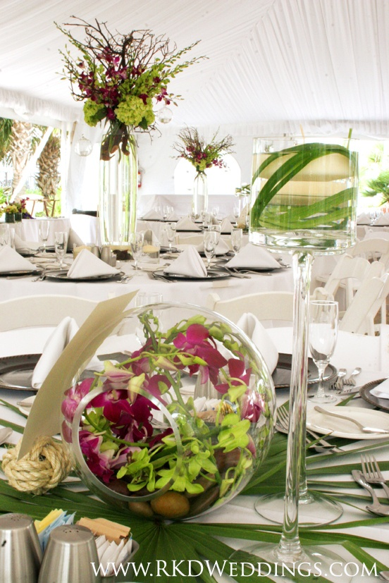 Tropical Centerpieces of green hydrangea, purple dendrobium orchids and green dendrobium orchids.