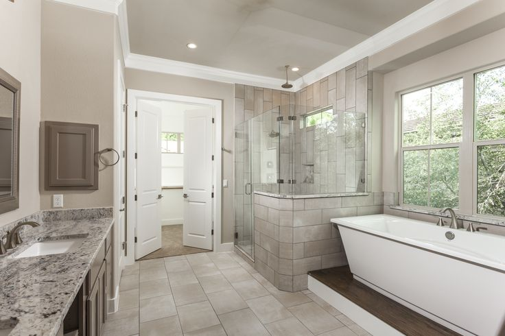 Transitional Master Bathroom Hill Country Contemporary Bathroom Free-standing tub Taupe bathroom Master retreat Kent Moore Cabinets