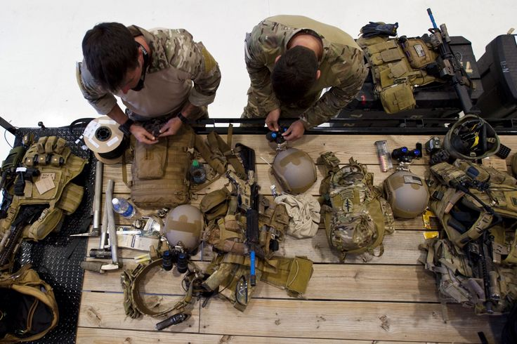 U.S. Army Special Forces soldiers prepare their equipment at McEntire Joint National Guard Base, S.C., May 19, 2014. (U.S. Air National Guard photo by Tech. Sgt. Jorge Intriago)