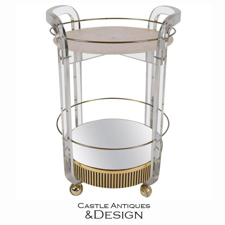 A modern rolling bar cart made of clear lucite and gold embellishments reminds me of something out of the roaring '20's. Check out more of our unique antique and vintage furniture and home decor by following the link. Our showroom is huge and it's located in North Hollywood, CA.