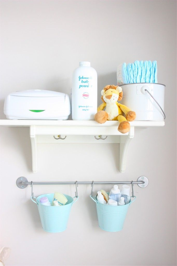 changing table organization, love the pails hanging on the wall IKEA!