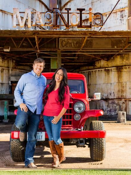 The Fixer Upper hosts stand outside their home furnishings shop, Magnolia Market. Their 1953 jeep is stationed by the entrance so customers can take pictures with it.