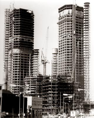 Detroit's Renaissance Center Construction C. 1974: I had a friend, now deceased, who did electrical engineering work on this.  THAT was NOT the remarkable part.  He lived about 7 miles from the site, in a beautiful neighborhood in the city, and JOGGED downtown to work most of the time, down Woodward through Highland Park and Detroit.