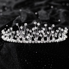 Rae Tiara - The 1 3/4 in. high Rae Tiara features a unique and elegant rhinestone design making it a must-have...