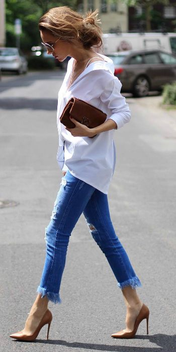 Alexandra Lapp + smart and sophisticated + fringed denim cut offs + white button down shirt + beige stilettos + simplistic leather clutch bag.   Jeans: Zara, Shirt: Steffen Schraut, Bag: Chanel. Spring Style.