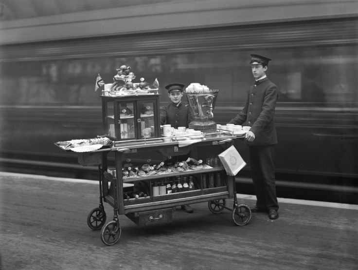 Young boys manning a refreshment trolley in Paddington station, 1910.