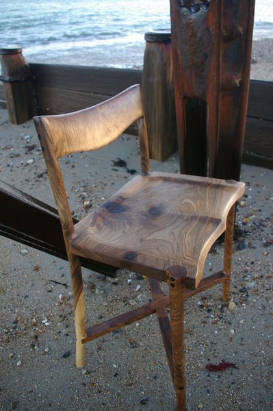 This is a beautifull sam maloof inspired solid english walnut chair, with ebony detail.