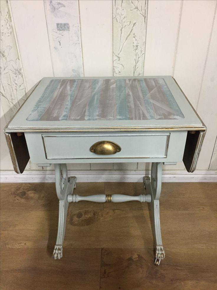Leather-topped, drop-leaf vintage side table, painted in Frenchic's Wedgewood, and French Linen, Original, and custom aqua. Sealed with clear wax, and highlighted with gilding wax.