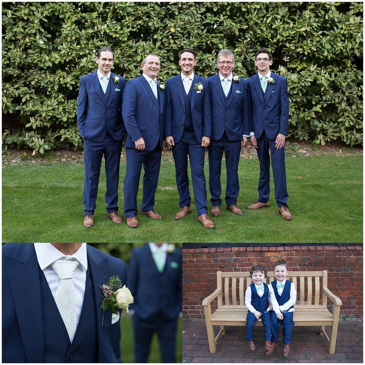 Groomsmen page boys ushers groom navy suits mint ties bow ties waistcoats buttonholes